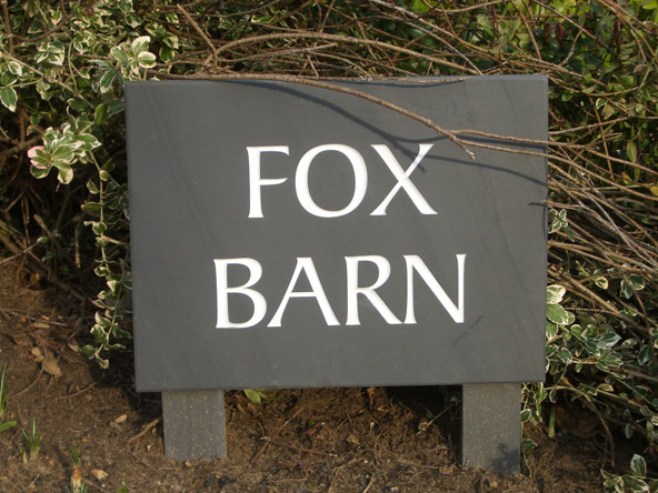 slate house sign with wooden stand